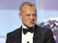 tv baftas 2013: host graham norton makes controversial jokes about jimmy savile and rolf harris