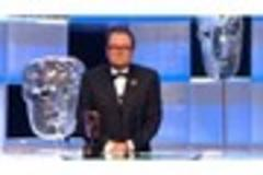 weymouth-born funnyman alan carr wins bafta award